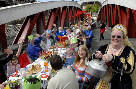 the-mad-hatters-tea-party-on-the-swing-bridge-669615566